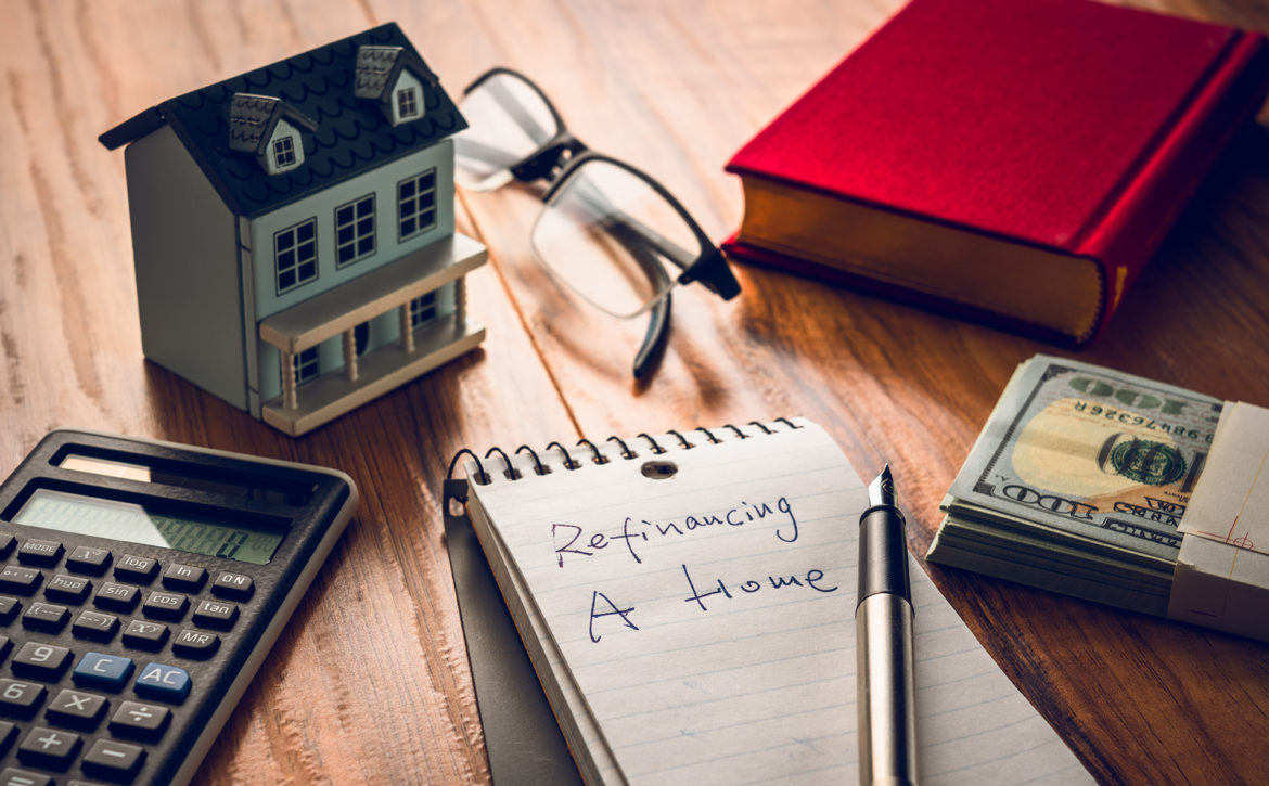 Refinancing,Words,On,Notebook,With,Us,Dollars,And,Stuff,On